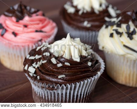 Sweet Delicious And High-calorie Chocolate Cupcake On A Wooden Background. Food Composition, Sweetne