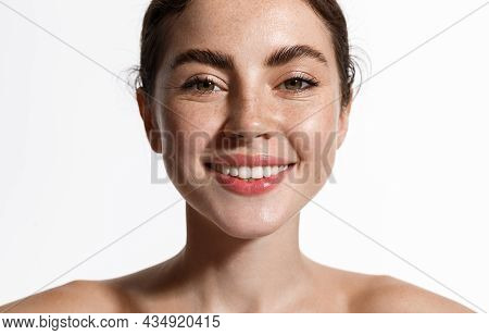 Spa And Skin Care. Smiling Beautiful Woman With Thick Eyebrows, Nourished Healthy Face, Showing Whit