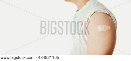 The Man Showing An Adhesive Bandage On The Arm With Copy Space