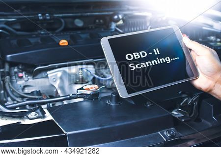 Technician Diagnostics Of Code Failure With Obd2 Scanner Technology On Tablet In The Auto Repair Gar