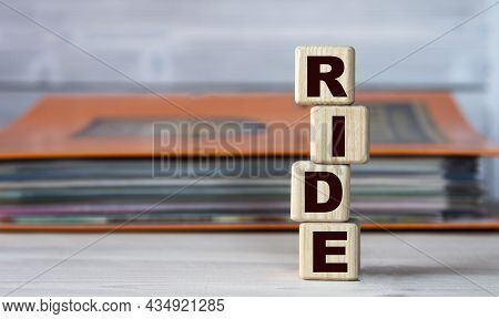 Ride - Acronym On Wooden Cubes On The Background Of A Folder With Documents. Business Concept