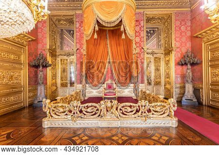 Turin, Italy - Circa August 2021: Old Throne Room Interior With Chair In Luxury Palace. Red And Gold