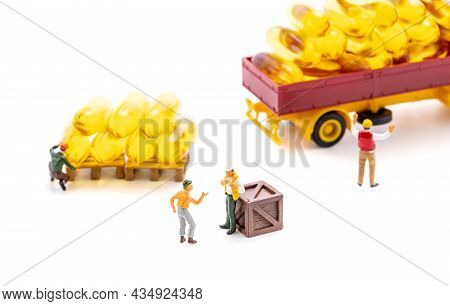 Miniature People Workers Transportation Fish Oil Supplement Capsules By Truck Isolated On White Back