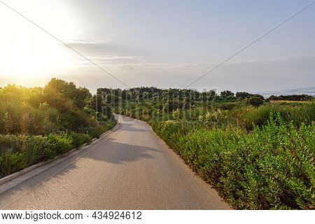 Scenic Road. The Road Is Surrounded By A Magnificent Natural Landscape.