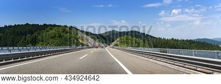 Cars Are Driving On The Expressway Or Autobahn.