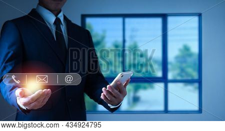 The Concept Is Customer Support Service, Contact Us, Help Centre. Man Hand Touching On The Mobile Ph
