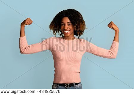 Women Power. Strong Powerful African-american Woman Raising Hands And Showing Her Biceps