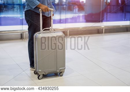 Traveler Passenger Hold Luggage At Terminal Airport Or Transit Flight With Suitcase In Journey Vacat