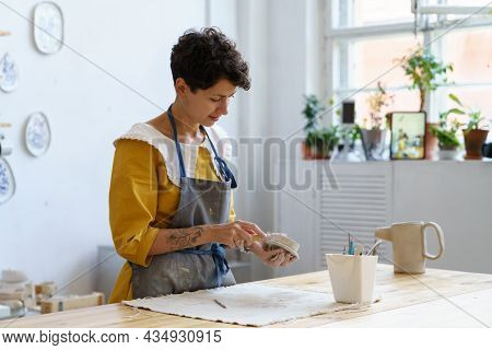 Handmade Pottery Business: Female Artist Making Ceramics For Sale And Teaching Art For Students At W