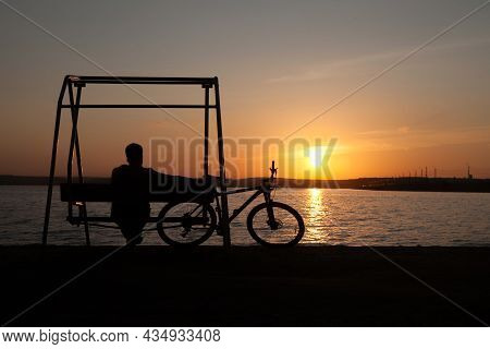 The Cyclist Rejoices At The Victory On The Shore Of The Lake.