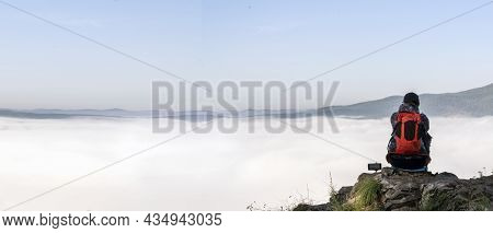 A Young Tourist Girl Contemplates The Morning Fog In The Mountains, Looks At The Sky. The Feeling Of