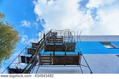 Scaffolding For Repair And Construction. Built Scaffolding In The Share Of The Repaired Wall Of The