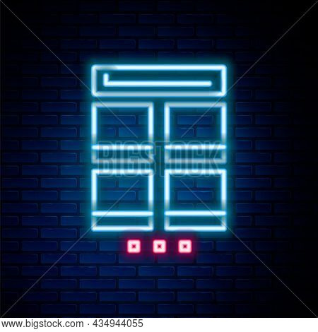 Glowing Neon Line Online Shopping On Mobile Phone Icon Isolated On Brick Wall Background. Internet S