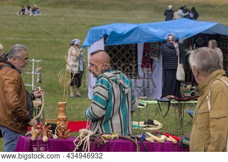 Kyiv, Ukraine - September 5, 2021: Open Air Traditional Crafts Fair. The Long Counters Display A Var