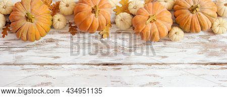 Autumn Top Border With Frosty Orange Pumpkins On A Rustic White Wood Banner Background. Above View W
