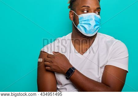 African-american Man In An Antiviral Mask Feels Unwell After Being Injected With The Covid-19 Corona
