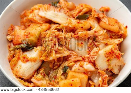 Traditional Korean Kimchi Cabbage In White Bowl. Healthy Food.
