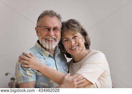 Head Shot Portrait Of Sincere Happy Older Generation Family Couple.