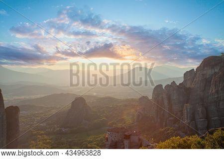 Meteora Monastery, Sunset Sky Clouds And Mountain In Meteora, Kalabaka, Greece