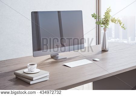 Close Up Of Creative Wooden Designer Desktop With Blank Mock Up Computer Monitor, Coffee Cup, Other