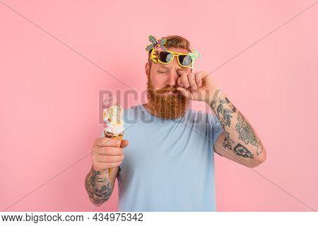 Cry Man With Beard And Tattoos Eats A Big Icecream
