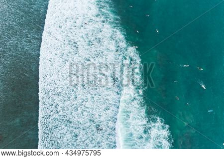 Amazing Aerial View Top Down Of Waves Break On Tropical Sea Surfers With Surfing Boards Aerial Drone