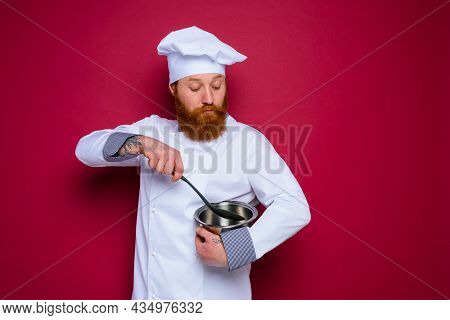 Doubter Chef With Beard And Red Apron Is Ready To Cook