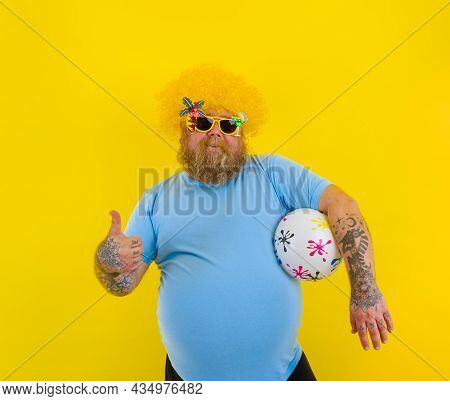 Fat Man With Wig In Head And Sunglasses Have Fun With A Ball