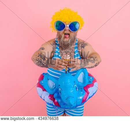 Fat Man With Beard And Wig Eats A Popsicle And An Icecream