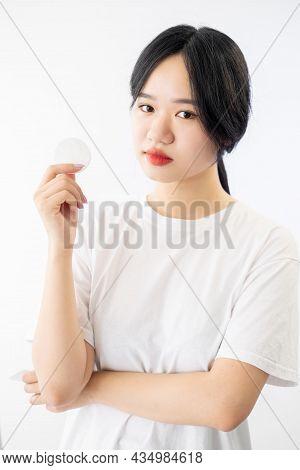 Morning Skin Care. Asian Woman. Nourishing Procedure. Pretty Oriental Lady Holding Cotton Pad In Han