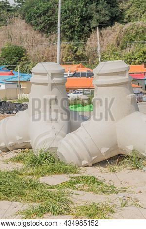 Tetrapods Used For Constructing Breakwater On Sandy Beach