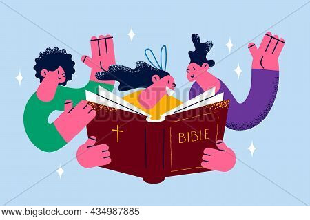 Religious Education And Church Concept. Group Of Smiling Happy Children Reading Bible Book Together