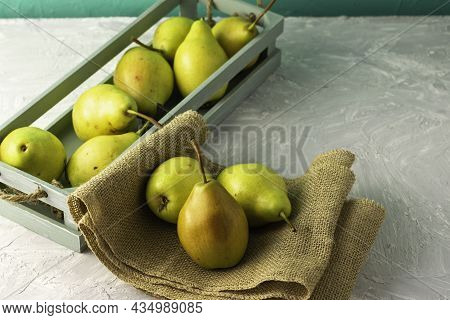 Ripe Juicy Pears In A Vintage Box Three Pears On Burlap Are Lying Next To Each Other