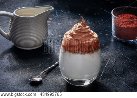 Dalgona Cold Coffee Recipe With Ingredients On A Black Background. Sweet Korean Drink Of Instant Cof