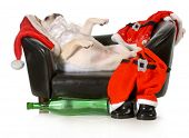 drunk santa - french bulldog santa laying on couch with wine bottle at feet isolated on white background poster