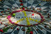 The Imagine symbol marks the spot in Strawberry Fields Central Park New York City whe John Lennon was shot and killed. poster