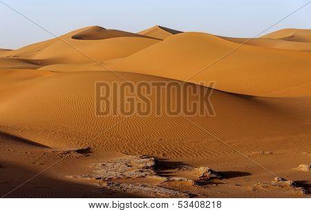 Sand dunes in Hamada du Draa moroccan stone desert (Morocco) poster