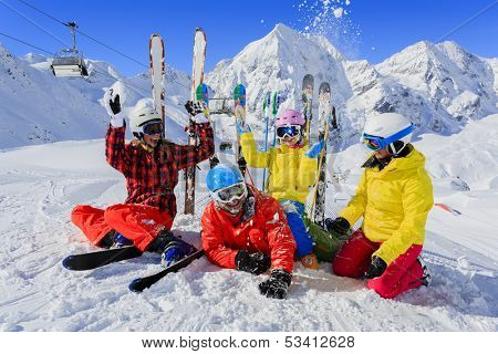 Ski, winter, snow, skiers, sun and fun - family enjoying winter vacations