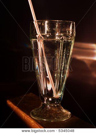Milkshake glass with water.