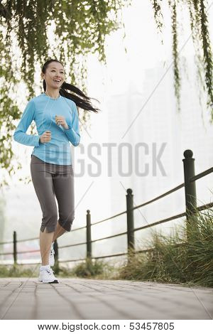 Young woman running in the park