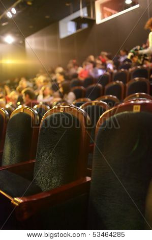 The empty seats in the theater at night poster