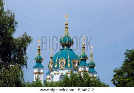 St. Andrew's Church among trees (Kiev Ukraine) poster