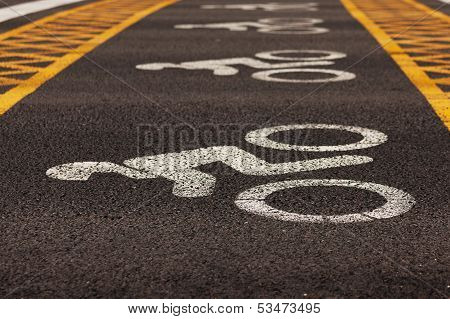 Road markings applied to asphalt pavement near the traffic lights poster