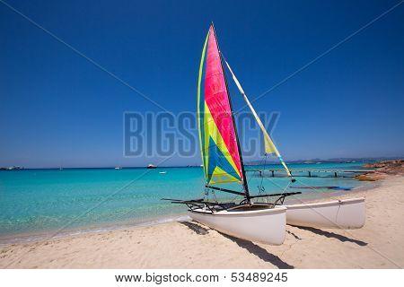 Catamaran sailboat in Illetes beach of Formentera at Balearic Islands