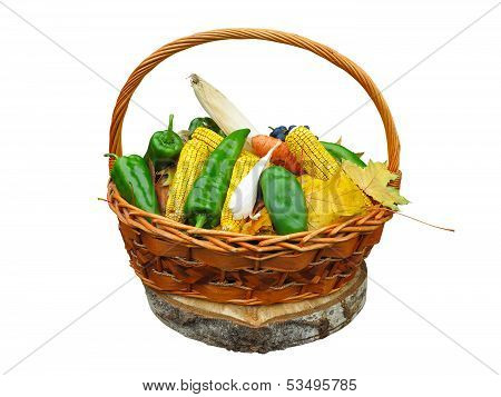 Corn Vegetables And Yellow Leaves In Basket Isolated On White