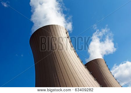 Cooling Towers Of A  Nuclear Power Plant Against Sky And Clouds