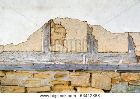 Adobe Wall, Old Plaster And Wooden Beams