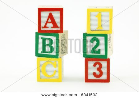 Wooden Blocks with letters/numbers on white background