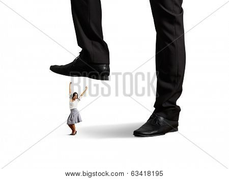cheerful businesswoman under big leg. isolated on white background