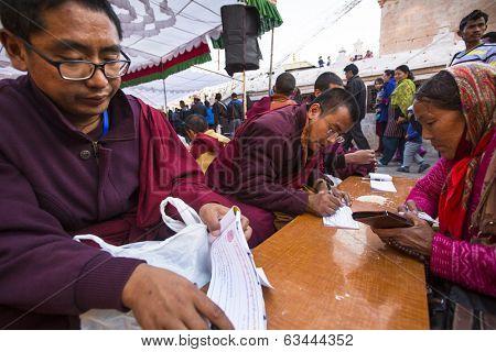 KHATMANDU, NEPAL - DEC 15, 2013: Unidentified tibetan Buddhist monks near stupa Boudhanath during festive Puja of H.H. Drubwang Padma Norbu Rinpoche's reincarnation's.